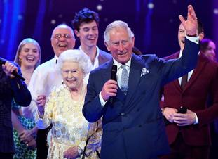 Charles leads in the audience in 'rousing cheers' for the Queen