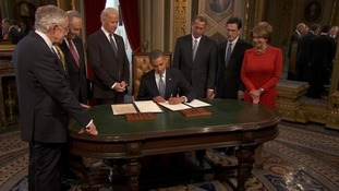 President Obama at signing ceremony in the presidential room at the Capitol