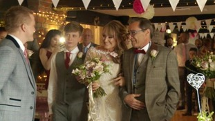 Father walks daughter down aisle at wedding weeks after new son-in-law saved his life