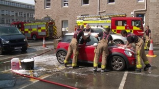 Firefighters raise more than £2,500 in charity car wash
