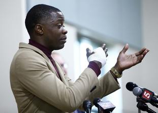 Hero James Shaw speaks during a press conference.