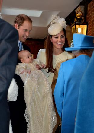 The Queen speaks with the Duke and Duchess of Cambridge at three month-old Prince George's christening.