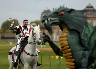 Performers act out the legend of St George and the dragon at Wrest Park in Silsoe.