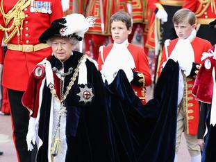 The Queen wearing her Garter badge decorated with the St George's flag at at St George's Chapel, Windsor Castle