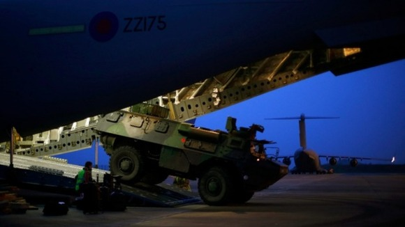 French military armoured personnel carrier is loaded on to a Royal Air Force C-17