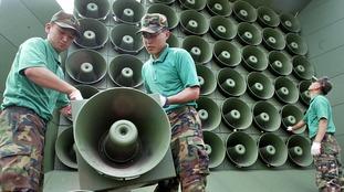 South Korea silences its propaganda broadcasts at border with North ahead of summit
