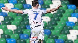Darren McAuley's double kept Coleraine's title hopes alive