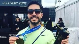 Matt pictured after finishing the Manchester Marathon