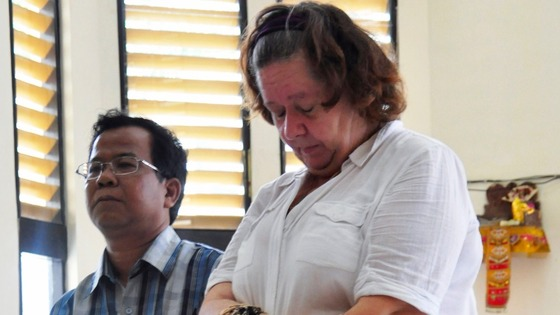 Sandiford, with her translator, listens to the judge during a trial in Denpasar in Bali