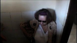 Sandiford tries to hide from the press
