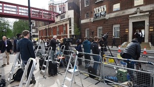 Waiting for the royals is a dense jungle of TV cameras, microphone stands, lights and step ladders