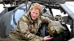 Prince Harry makes his early morning pre-flight checks at Camp Bastion, southern Afghanistan.