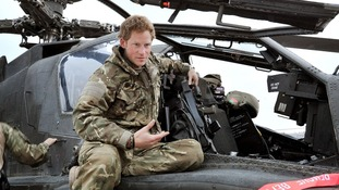 Prince Harry outside his Apache helicopter.