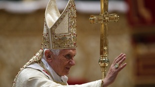 Pope Benedict XVI blesses faithful at the end of a Chrism Mass in St. Peter's Basilica at the Vatican