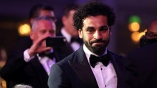 How does humble star Salah look after the people back home?