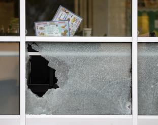 .Damaged windows at the Waffle House restaurant.