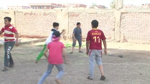 Children wearing the Roma Mohamed Salah jersey.