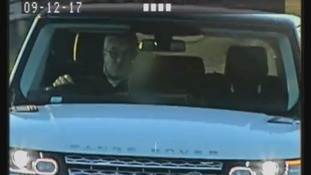 Timothy Hill gesturing at a speed camera