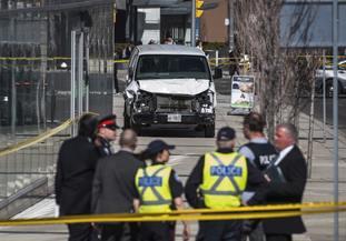 Police in Toronto after a van mounted a pavement and crashed into pedestrians (Aaron Vincent Elkaim/The Canadian Press via AP)