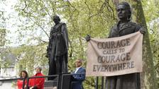 Millicent Fawcett is the only female statue in Parliament Square, standing alongside 11 historical male figures. (Stefan Rousseau/PA)