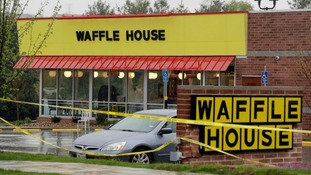Police tape blocks off the Waffle House restaurant