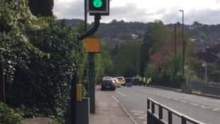 Police at the scene of the crash in Cainscross Road in Stroud.