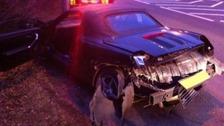 A badly damaged car on the A40.