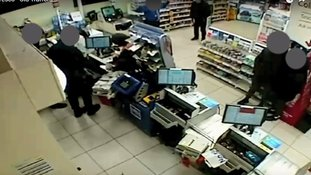 Tesco staff and customers feared for their lives as a store was held-up at gunpoint by a pair of masked robbers.