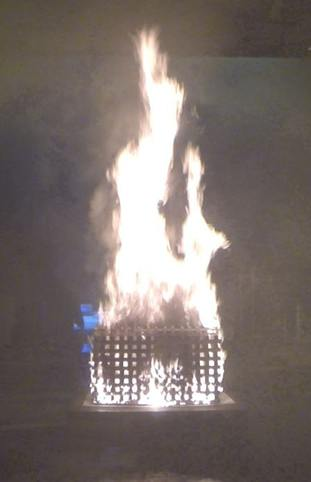 A mixed wood and plastic crib burns during tests