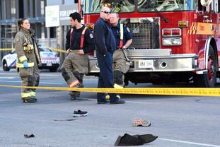The van apparently jumped a curb in a busy intersection in Toronto. (Nathan Denette/The Canadian Press/AP)
