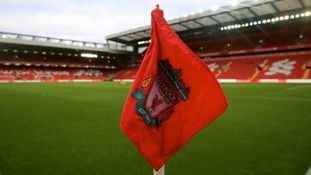 Liverpool FC flag on pitch at Anfield
