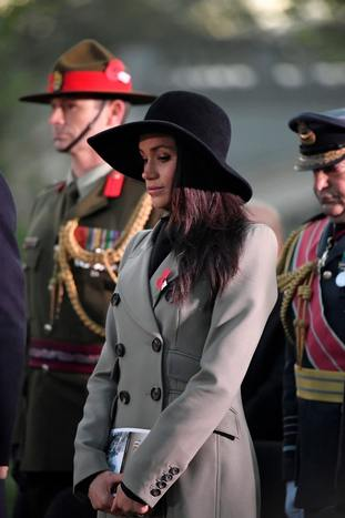 Ms Markle wore a grey coat and large brimmed hat. (Toby Melville/PA)
