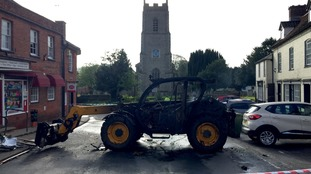 The JCB was set on fire and left at the scene.
