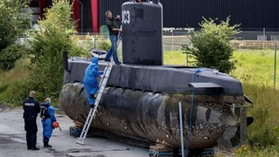 Police examine the submarine in Copenhagen.