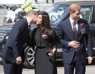 The Duke of Cambridge greets Meghan Markle and Prince Harry as they arrive at Westminster Abbey (Jonathan Brady/PA)
