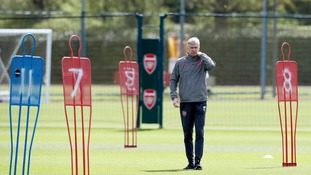 Arsenal boss Arsene Wenger has suggested the timing to announce his departure was forced upon him