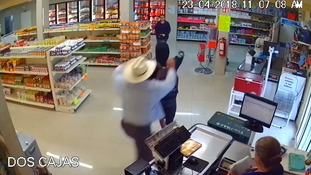 Cowboy hat-wearing hero tackles gunman in Mexican supermarket attempted armed robbery
