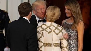 Donald Trump greets first lady of France Brigette Macron
