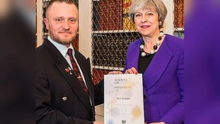 Phil Burton was recognised for his work with an award for combating social isolation.