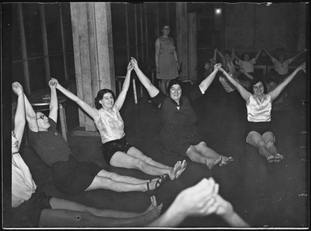 This image of an exercise class was accompanied with a description which says 'Peckham mothers can keep that schoolgirl figure'.