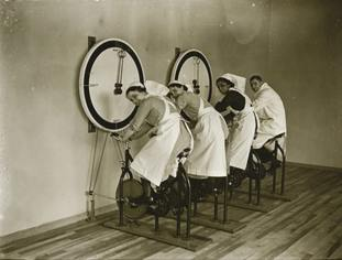Nurses try out exercise bikes at a gym in the new Albert Dock Hospital.