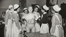 Student nurses learning to bandage a mannequin
