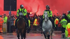 Two charged over Anfield incident which left fan critically injured