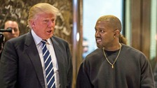 Kanye West looking really happy and smiling next to US President Donald Trump at the Trump Tower.