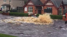 Burst water pipe floods road in Black Country