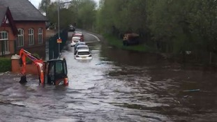 Several cars have been submerged after a water main burst in the Black Country.