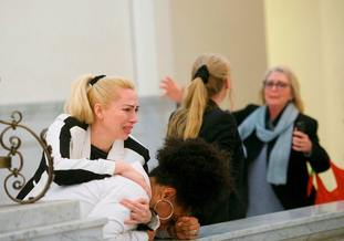 Bill Cosby accusers, from left, Caroline Heldman, Lili Bernard and Victoria Valentino, right, react outside the courtroom  (Mark Makela/Pool Photo via AP)