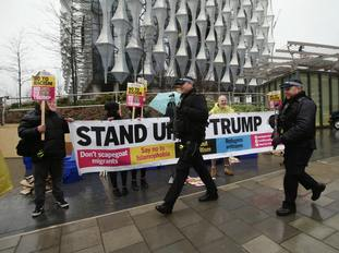 Anti-Trump protesters outside the new US Embassy in Nine Elms, London (PA)