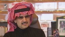 Saudi Prince Al-Waleed bin Talal speaking to John Irvine