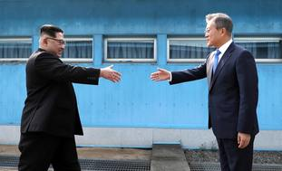 The leaders shook hands across the military demarcation line